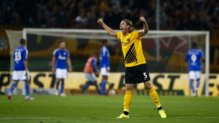 Dynamo Dresden's Michael Hefele celebrates after his team scored  against Schalke 04 during their German soccer cup match in Dresden