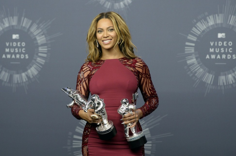 Beyonce poses with her awards during the 2014 MTV Video Music Awards in Inglewood