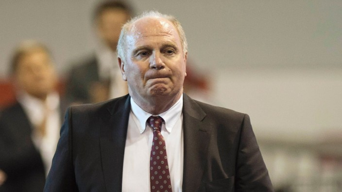 Bayern Munich's former president Hoeness reacts during an extraordinary general meeting of the German Bundesliga first division soccer club in Munich