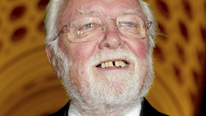 File picture shows British filmmaker Sir Richard Attenborough arriving at a reception hosted by Britain's Queen Elizabeth II at Buckingham Palace in London