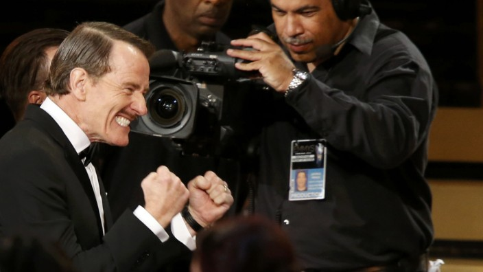 Actor Bryan Cranston reacts as he takes the stage after 'Breaking Bad' was named Outstanding Drama Series during the 66th Primetime Emmy Awards in Los Angeles