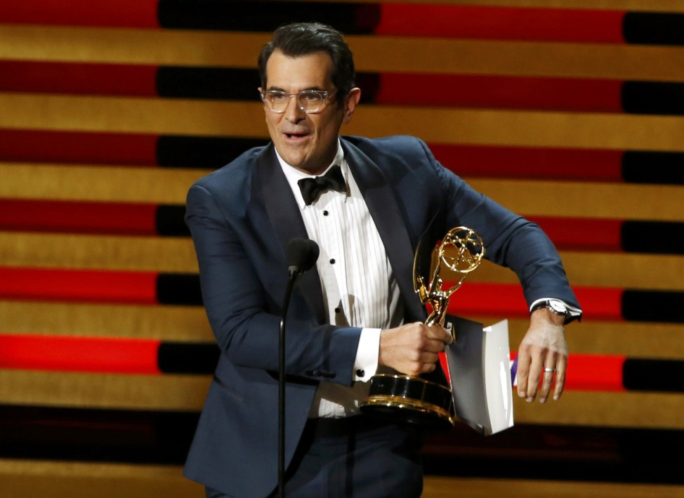 Actor Ty Burrell accepts the award for Outstanding Supporting Actor In A Comedy Series for his role in 'Modern Family' onstage during the 66th Primetime Emmy Awards in Los Angeles