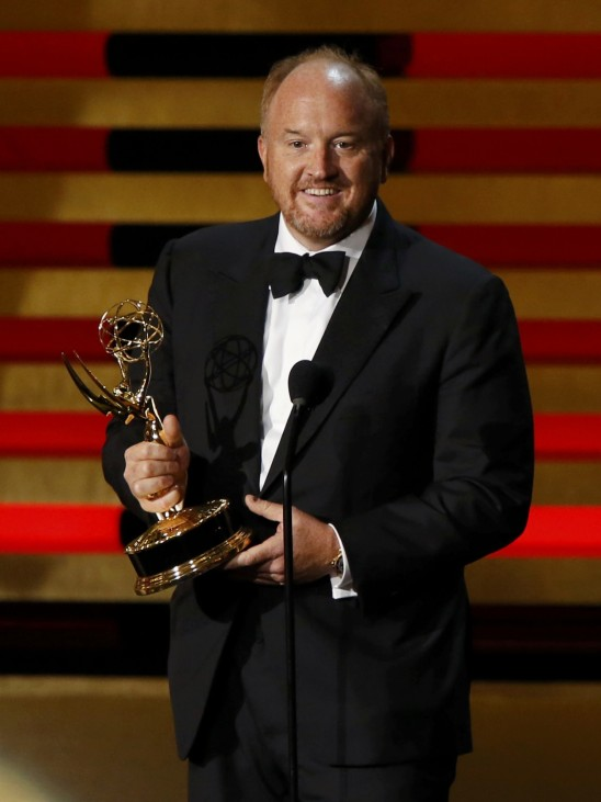 Louis C.K. accepts the Emmy award for Outstanding Writing for a Comedy Series for 'Louie' during the 66th Primetime Emmy Awards in Los Angeles