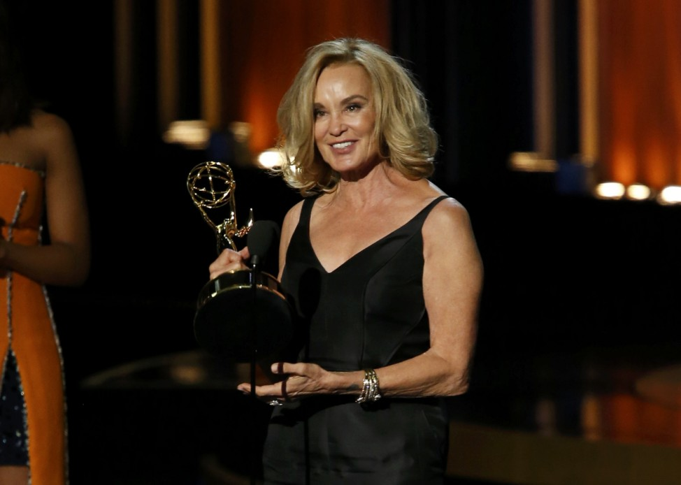 Jessica Lange accepts the award for Outstanding Lead Actress In A Miniseries Or A Movie for her role in 'American Horror Story: Coven' during the 66th Primetime Emmy Awards in Los Angeles