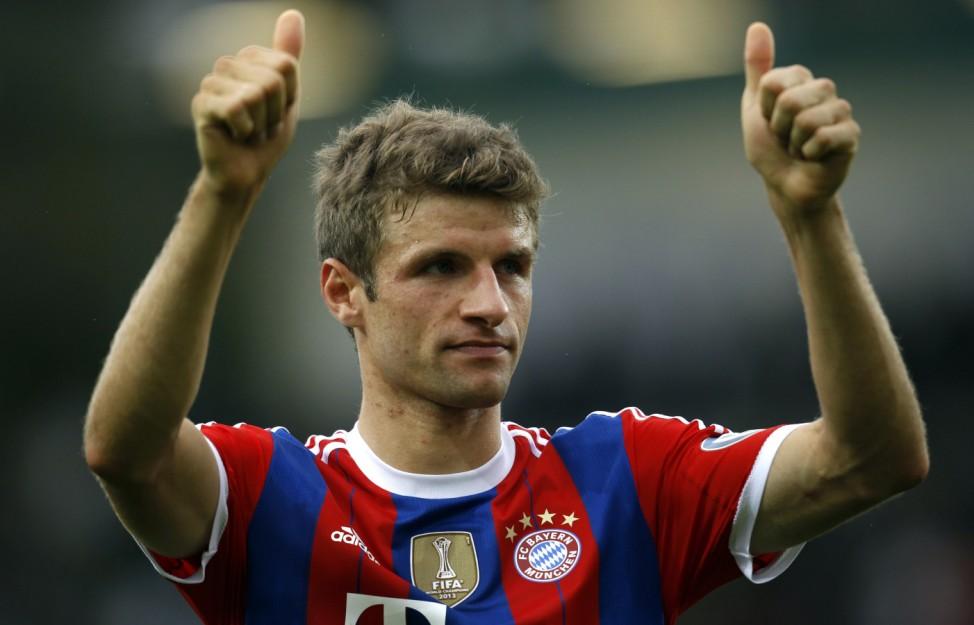 Bayern Munich's Mueller celebrate their victory over Preussen Muenster after their German soccer cup (DFB Pokal) first round soccer match in Muenster