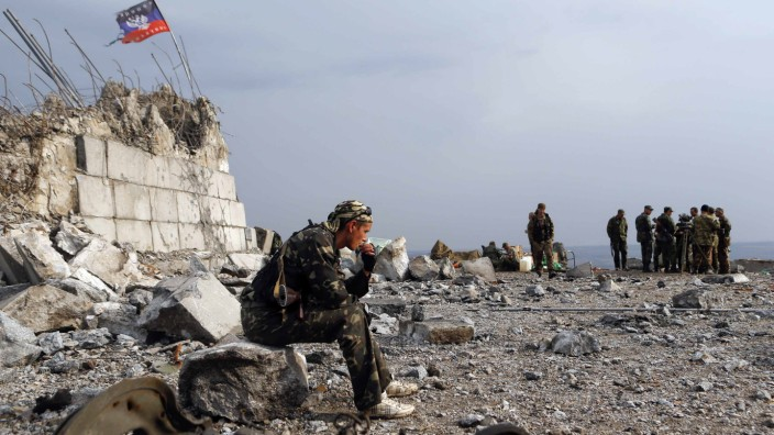 A Pro-Russian separatist sits at his position at Savur-Mohyla