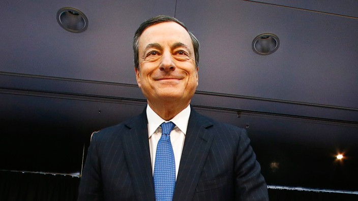 European Central Bank (ECB) President Mario Draghi arrives  for the monthly ECB news conference in Frankfurt