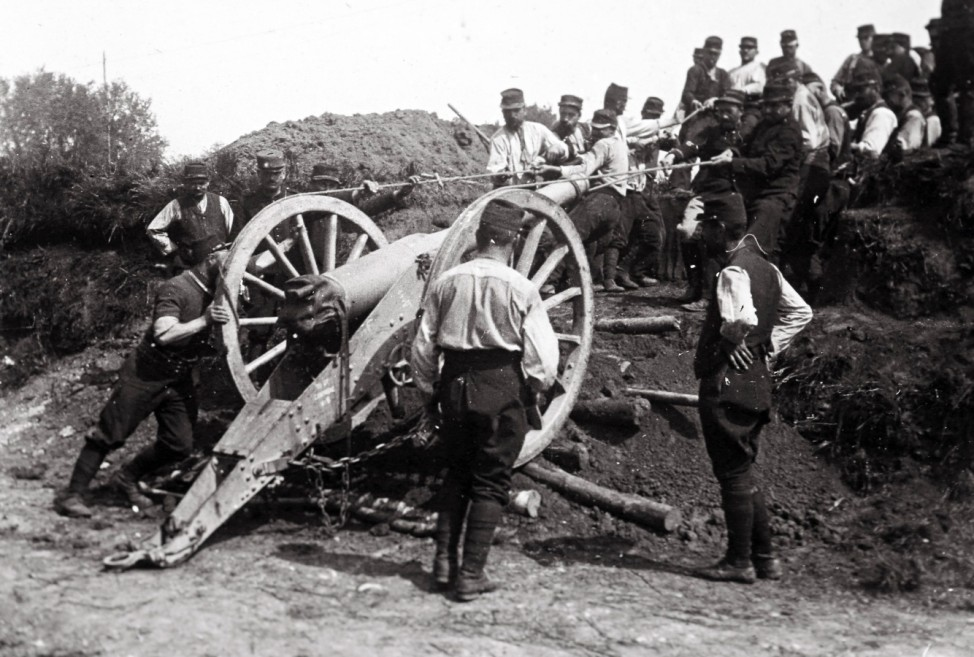 An undated archive picture shows French soldiers moving a 95 mm cannon, on the rear guard near the front, at unknown location in France