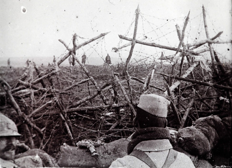An undated archive picture shows German soldiers offering to surrender to French troops, seen from a listening post in a trench at Massiges, northeastern France