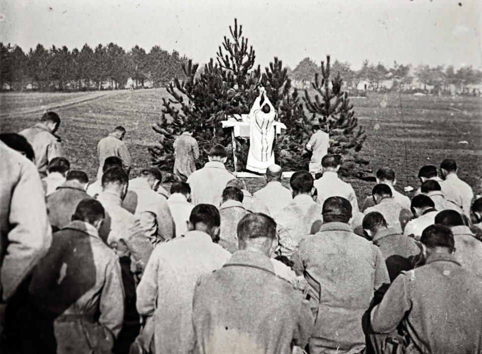 An archive picture shows a priest conducting mass for French soldiers on the Champagne front, eastern France