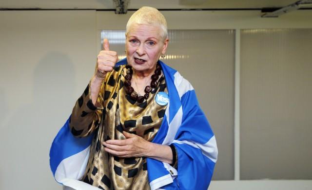 Designer Vivienne Westwood gestures backstage before the presentation of her Vivienne Westwood Red Label Spring/Summer 2015 collection during London Fashion Week
