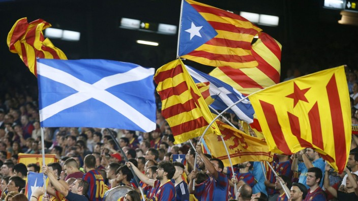 Catalunya's separatist supporters wave 'Esteladas' supporting Scotland's independence during FC Barcelona's Champions League soccer match against Apoel Nicosia in Barcelona