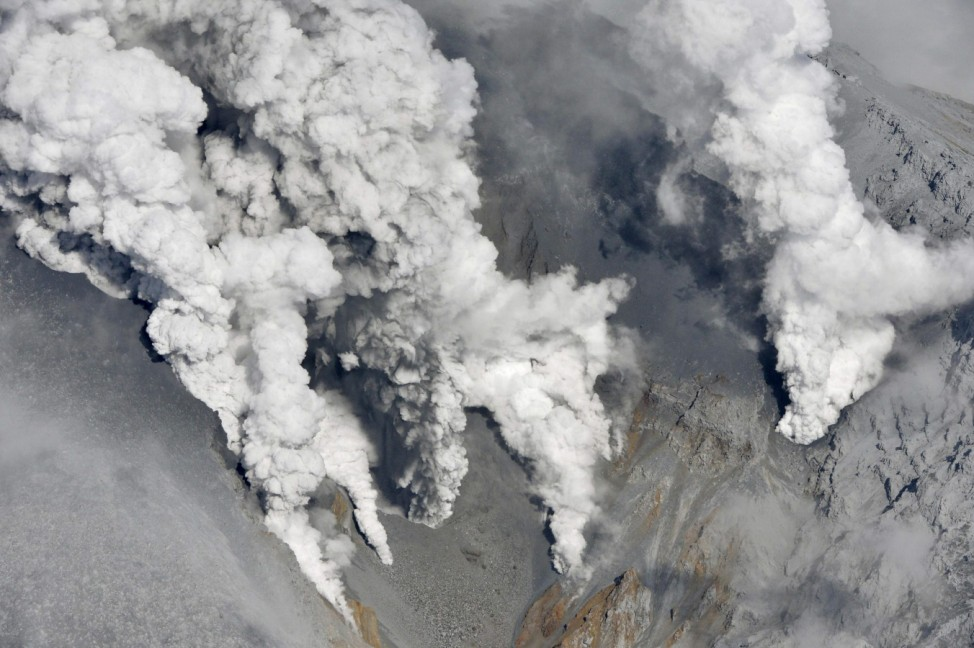 Smoke rises from Mount Ontake, which straddles Nagano and Gifu prefectures