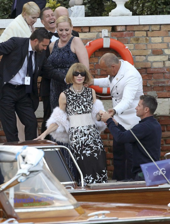 U.S. Vogue editor Wintour gets help to board a taxi boat transporting guests to the venue of a gala dinner ahead of the official wedding ceremony of U.S. actor Clooney in Venice