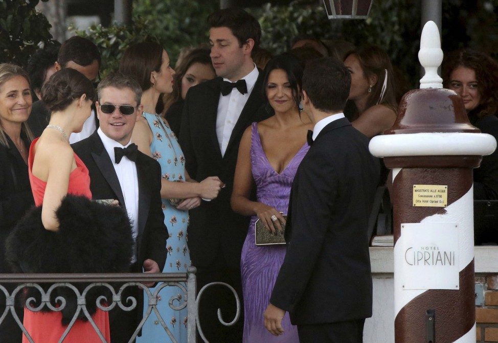 U.S. actor Damon and his wife arrive to board a taxi boat transporting guests to the venue of a gala dinner ahead of the official wedding ceremony of U.S. actor Clooney in Venice