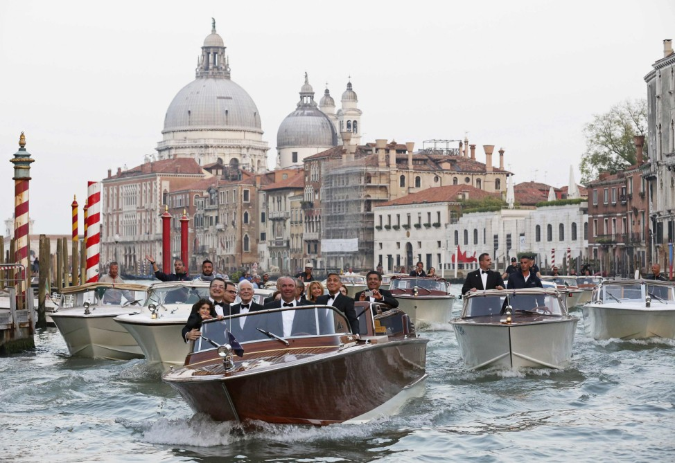 U.S. actor Clooney travels on a taxi boat to the venue of a gala dinner ahead of his official wedding ceremony in Venice