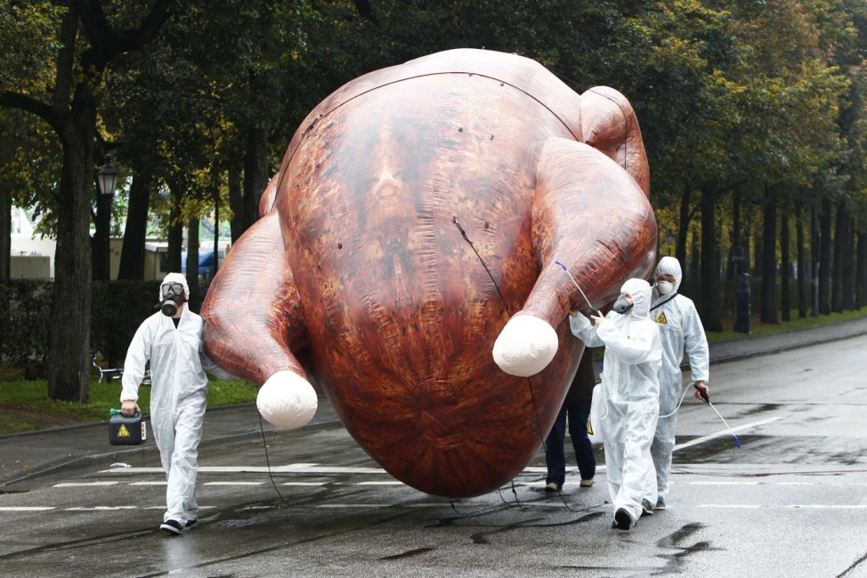 Environmental activists carry a giant inflatable chicken near Oktoberfest grounds in Munich