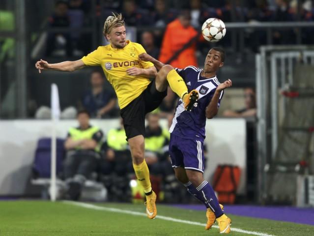 Borussia Dortmund's Schmelzer challenges Anderlecht's Tielemans during their Champions League group D soccer match in Brussels