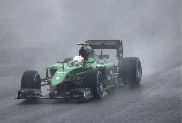 Caterham Formula One driver  Kobayashi of Japan drives during the Japanese F1 Grand Prix at the Suzuka Circuit