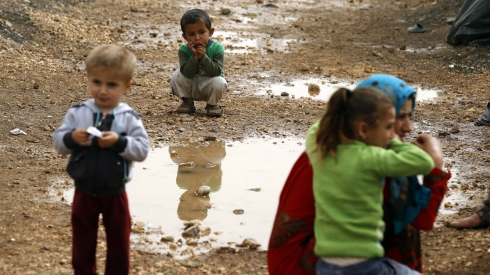 Kurdish refugees from the Syrian town of Kobani are pictured in a camp in the southeastern town of Suruc, Sanliurfa province