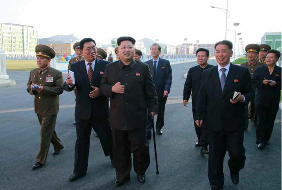 Kim Jong-un walking with a cane