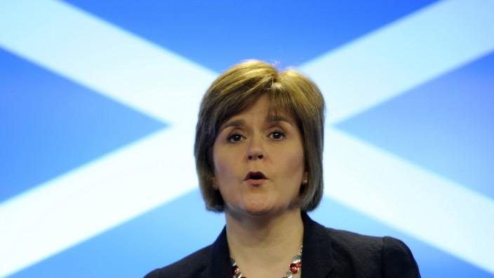File photograph show Scotland's Health Secretary Nicola Sturgeon speaking at a news conference in Edinburgh