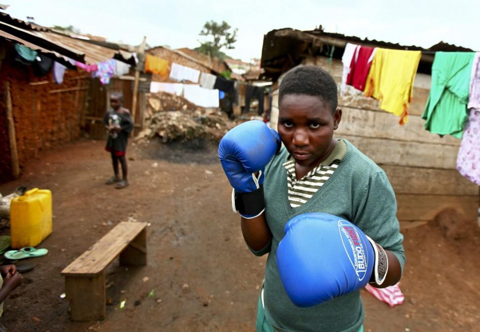Nantale poses outside her house in Katanga slum, one of the biggest slums in Uganda's capital Kampala