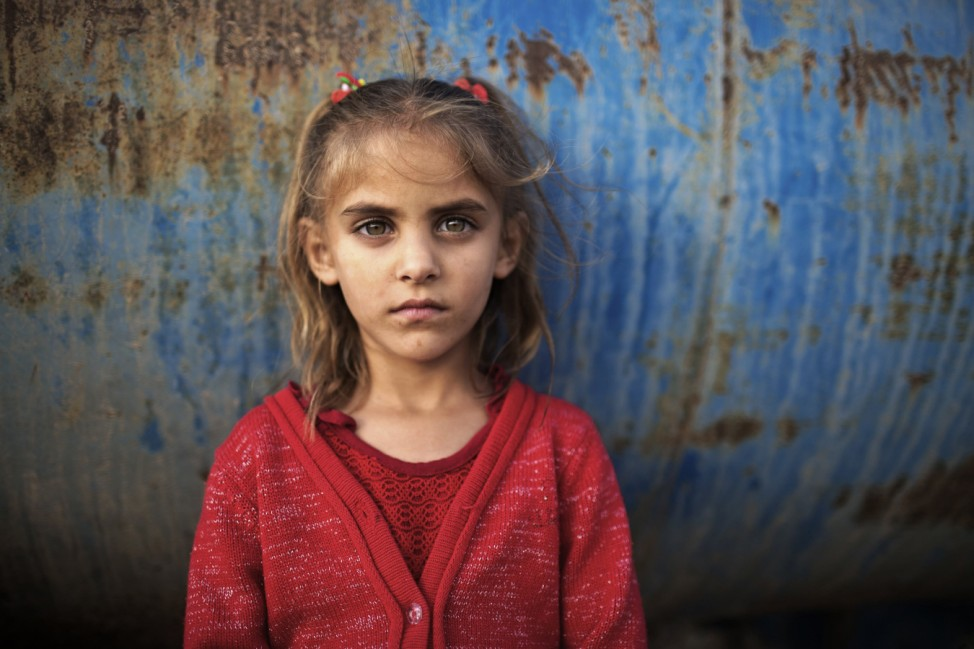 Five-year-old Bedouin girl Tuqa Abu Alqean poses for a portrait in the 'unrecognised' village of Um Al-Hiram in southern Israel's Negev desert