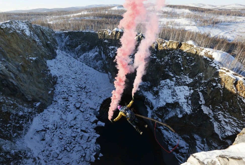 A member of the 'Exit Point' amateur rope-jumping group takes a rope jump in Khakassia region
