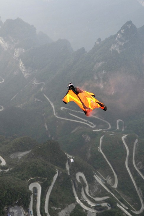 Wingsuit flyer contestant Melissa Pemberton of the U.S. jumps off a mountain at Tianmen Mountain National Park in Zhangjiajie