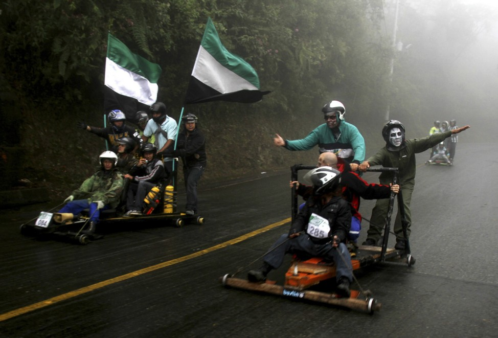 Participants descend a hill on a homemade cart during the 25th Roller Cart Festival in Medellin