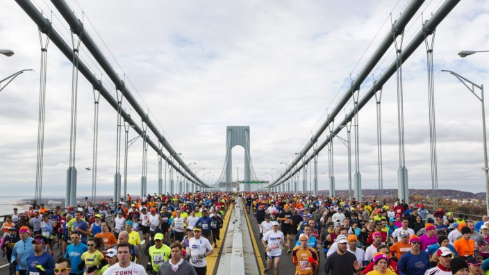 Runners cross the Verrazano-Narrows Bridge during the New York City Marathon in New York