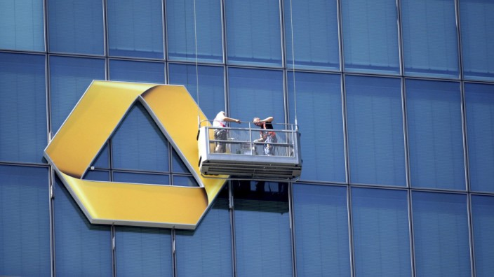 File photo of workers making adjustments to a large Commerzbank logo in Frankfurt