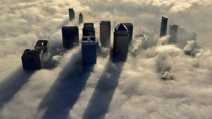 The Canary Wharf business district of east London taken from the Metropolitan Police helicopter is seen during a foggy morning in this photograph received via the Metropolitan Police in London