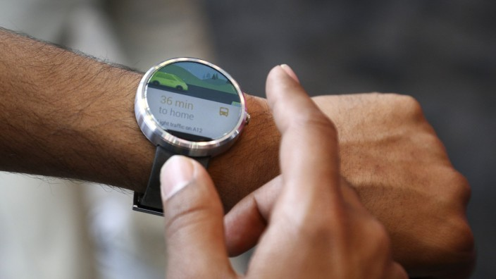File photo of a Google employee demonstrating the features of the Moto smartwatch at the Google I/O developers conference in San Francisco