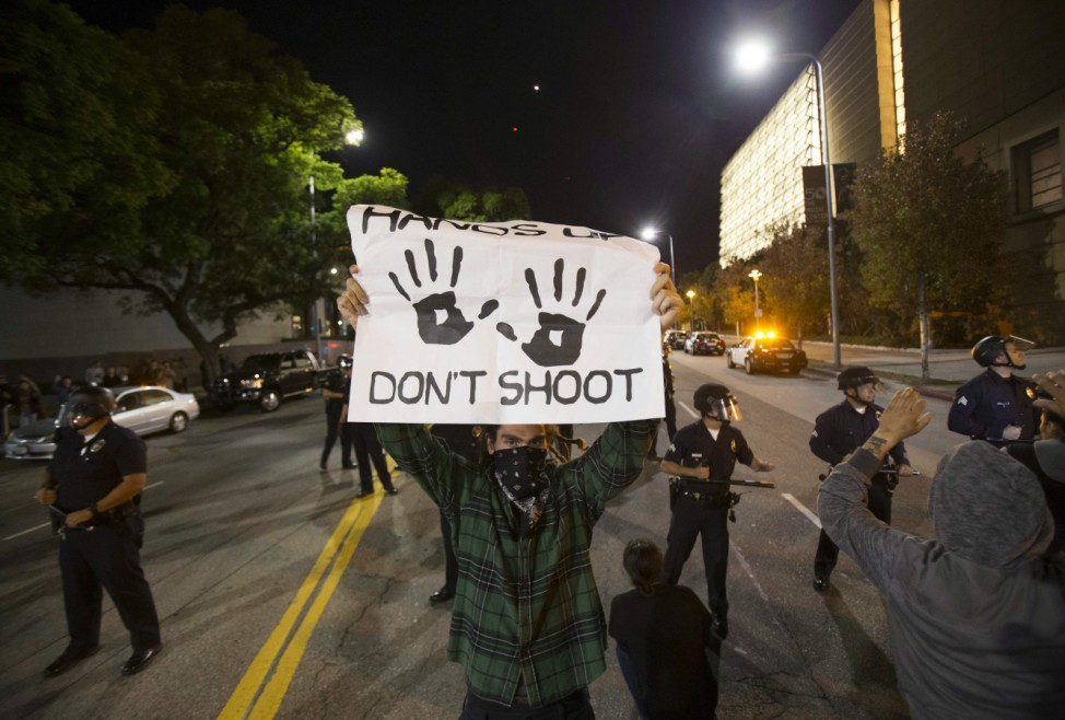 Protester holds a sign during a march in Los Angeles, California