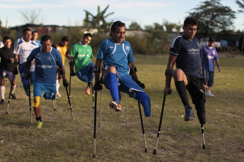 Members of the Salvadorean national amputee soccer team take part in  training session at La Estrella soccer field in San Salvador