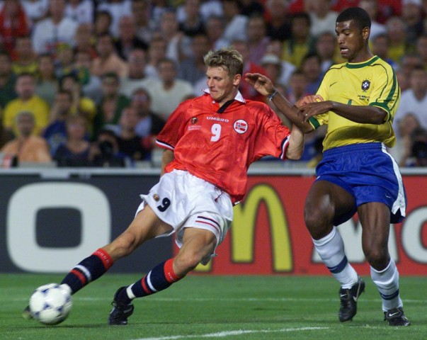 NORWAY'S TORE ANDRE FLO TURNS PAST BRAZIL'S BAIANO TO SCORE