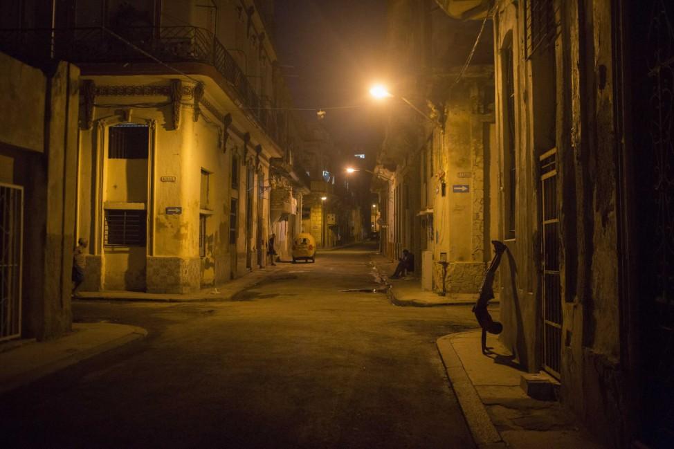 A boy plays on a street in downtown Havana
