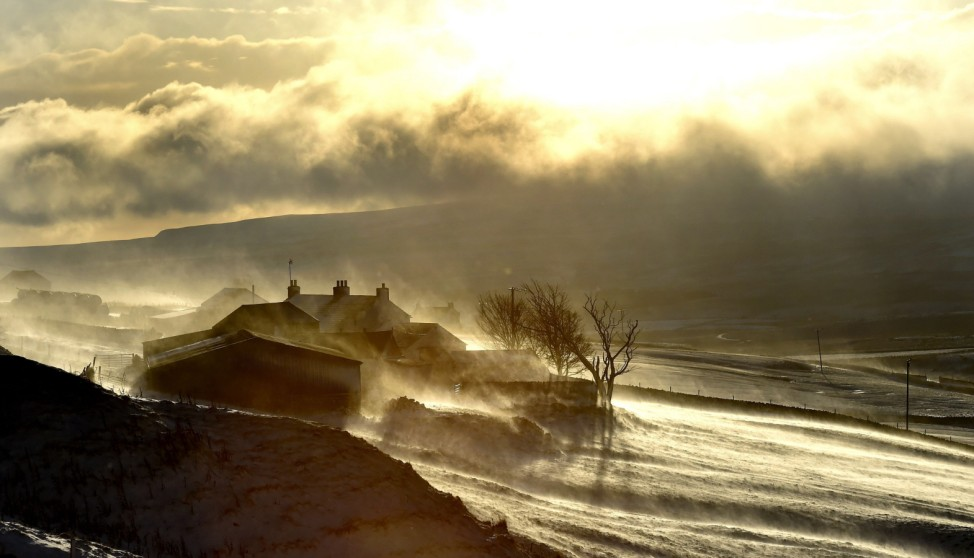 Snow drifts over a farm in Teesdale, County Durham after an overnight downfall,