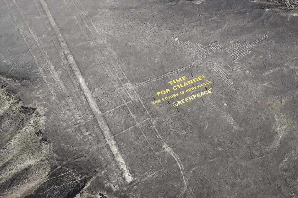 A photo released by Greenpeace activists of a climate change banner beside the historic Nazca lines located on a stretch of coastal desert in Peru