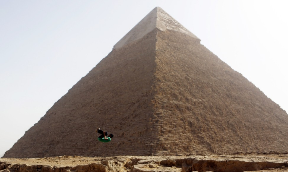 Member of Egyptian parkour group 'EGY PK', practices jump in front of Pyramid of Khufu, the largest of the Great Pyramids of Giza, on the outskirts of Cairo