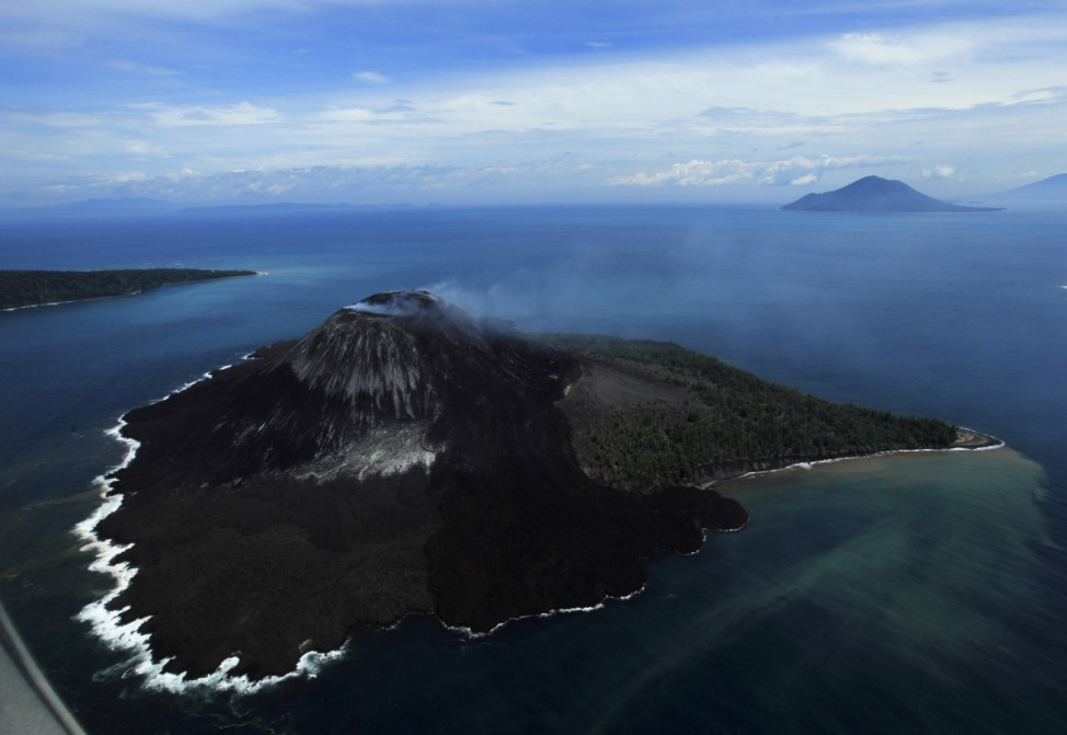 An aerial view of Anak Krakatau volcano spewing ash and smoke in the Sunda strait