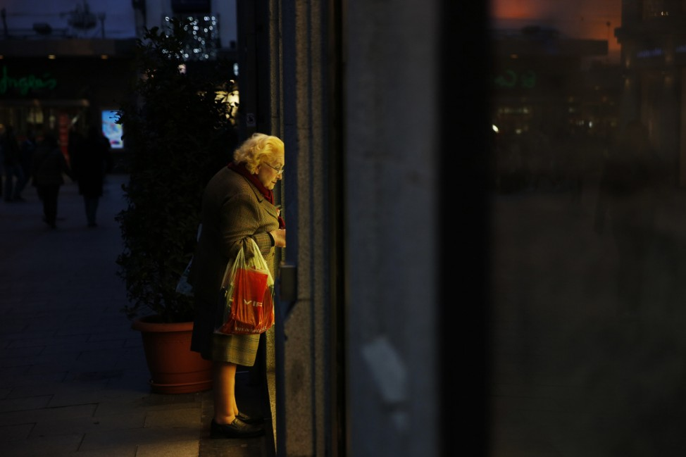 A woman window shops in central Madrid