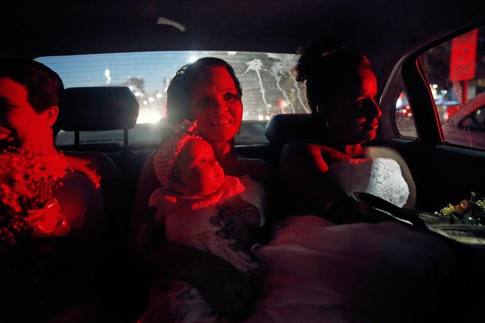 Brides ride a police car to their group wedding in Rio de Janeiro