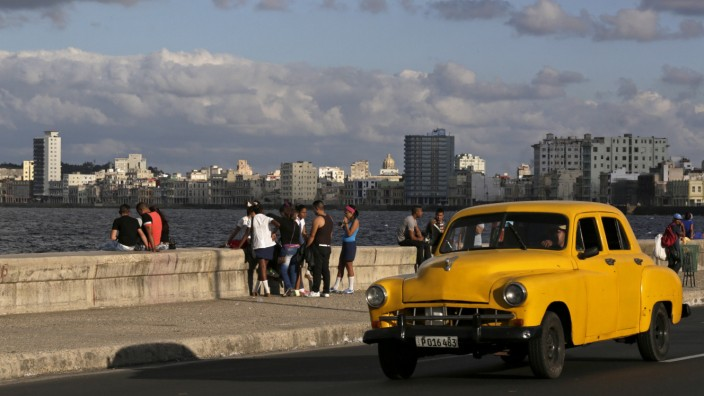 Youth sit on Havana's El Malecon seafront bolulevard
