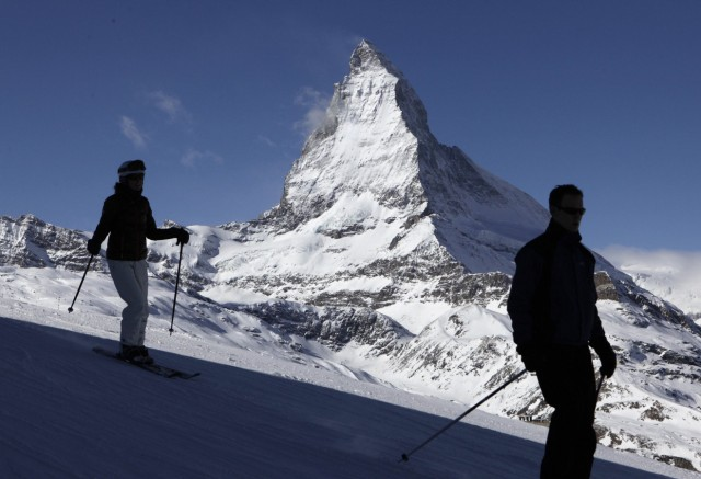 File photo of skiers speeding down in front of Matterhorn mountain at Riffelberg in the ski resort of Zermatt