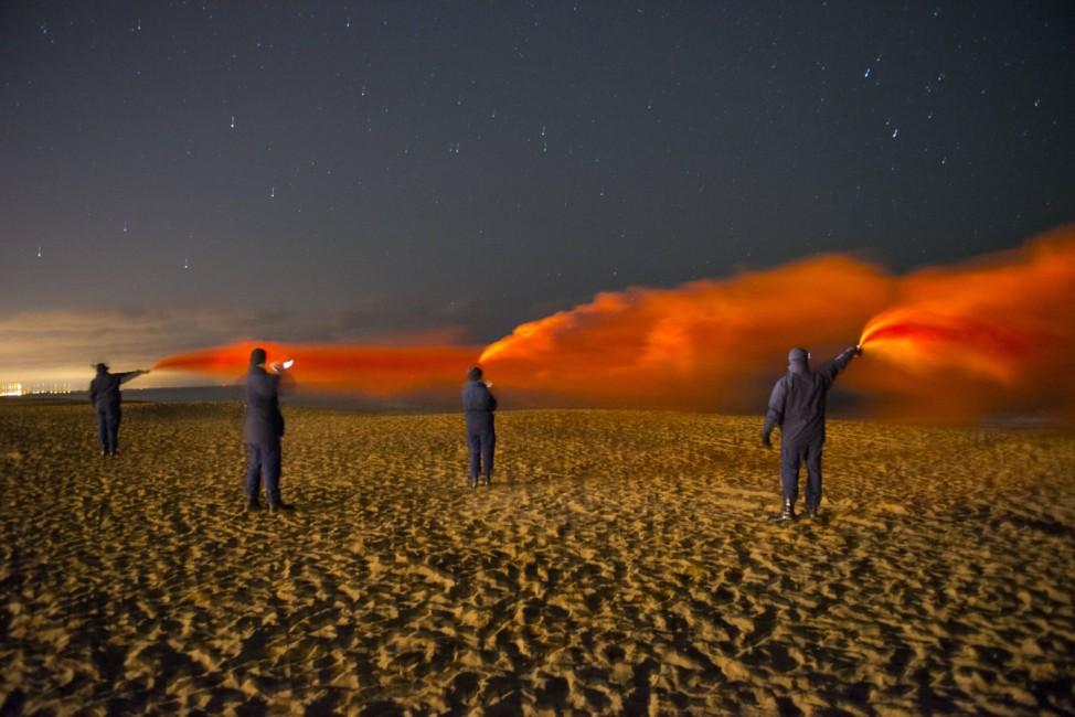 U.S. Coast Guard members conduct flare training on Plum Island