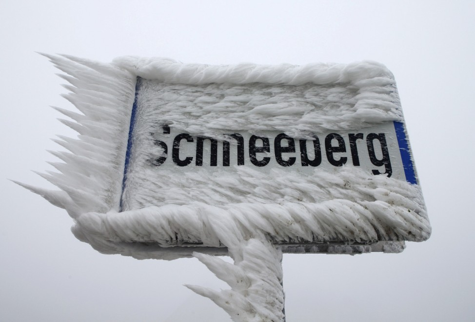 A village sign is covered with ice in Schneeberg