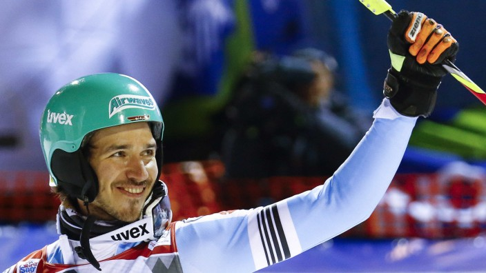 Neureuther of Germany reacts crossing the finish line to win the men's World Cup Slalom skiing race in Madonna di Campiglio